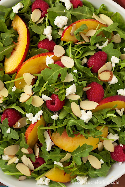 Overhead closeup photo of a dish of Raspberry Arugula Salad.