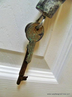 recycled aged keys at tail of table leg dragonfly