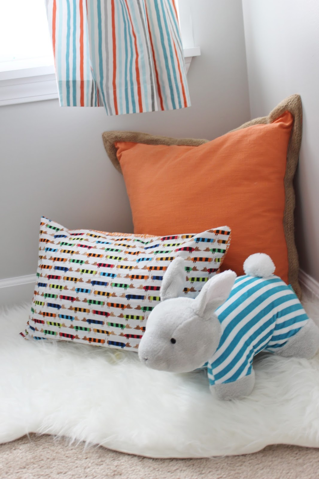 Aqua, Orange, and Grey Nursery with Stripe Wall and Lots of DIY Projects #nursery #diy