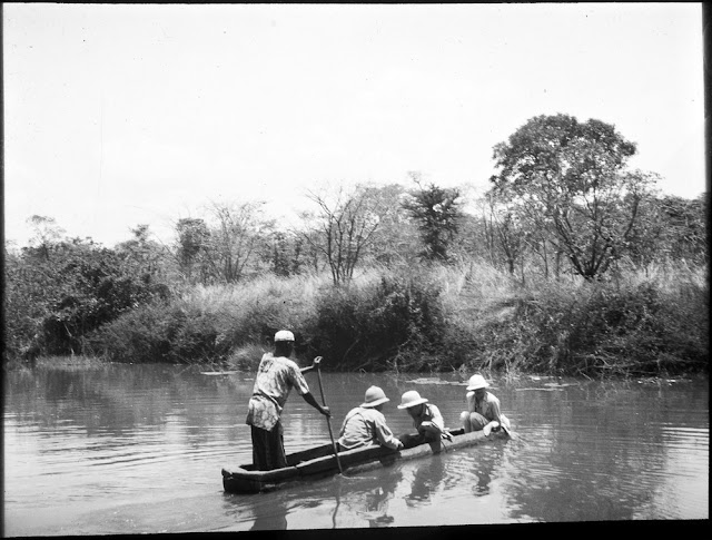 Survey team in dugout canoe. E.O. Teale photograph collection.