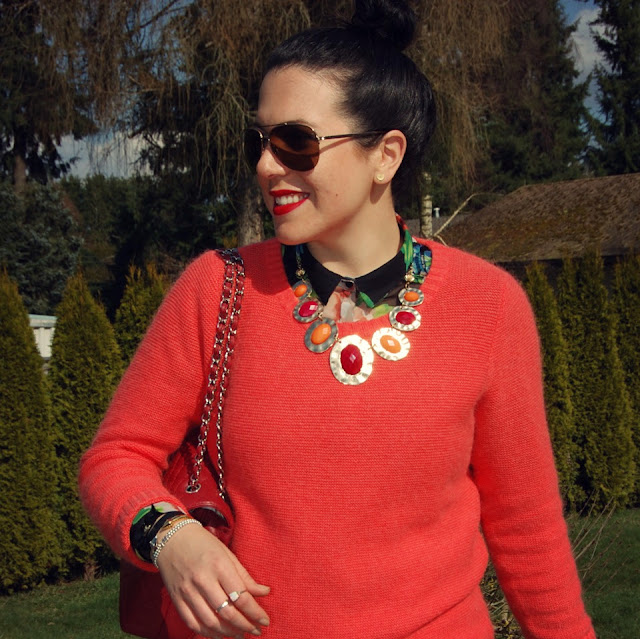 Floral blouse, coral sweater, red J brand jeans, Chanel flap handbag, statement necklace, Zara suede boots.