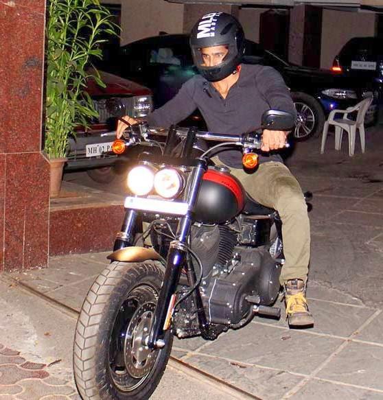 Sidharth Malhotra snapped outside Karan Johar's house on a bike