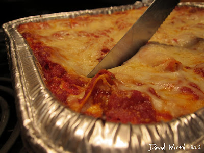 Cutting Homemade Lasagna From the Oven