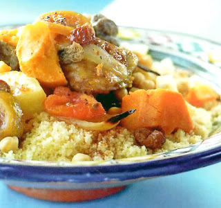 Stew of lamb and squash in a spiced tomato base served on a bed of couscous