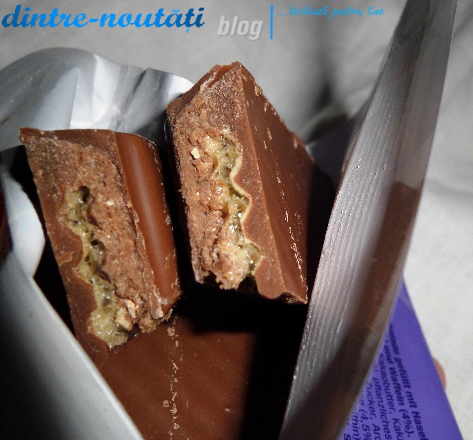 Ciocolata cu lapte din Alpi umplută cu cremă de alune (42%), cu alune crocante (3,5%) și vafă (4%)