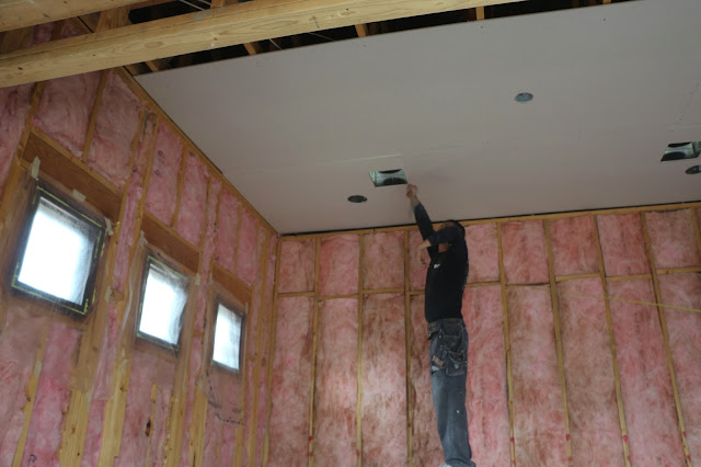 hanging drywall sheetrock on ceiling