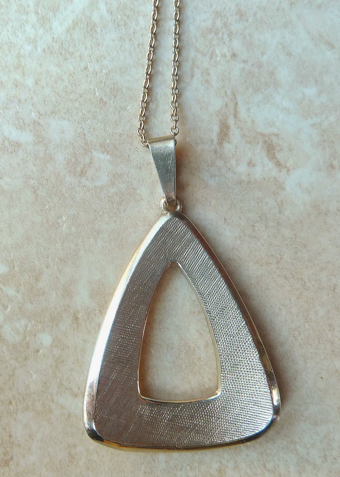 http://www.kcavintagegems.uk/vintage-modernist-style-sterling-silver-triangle-pendant-and-chain-335-p.asp