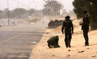 Libya NTC's rebels laying landmines
