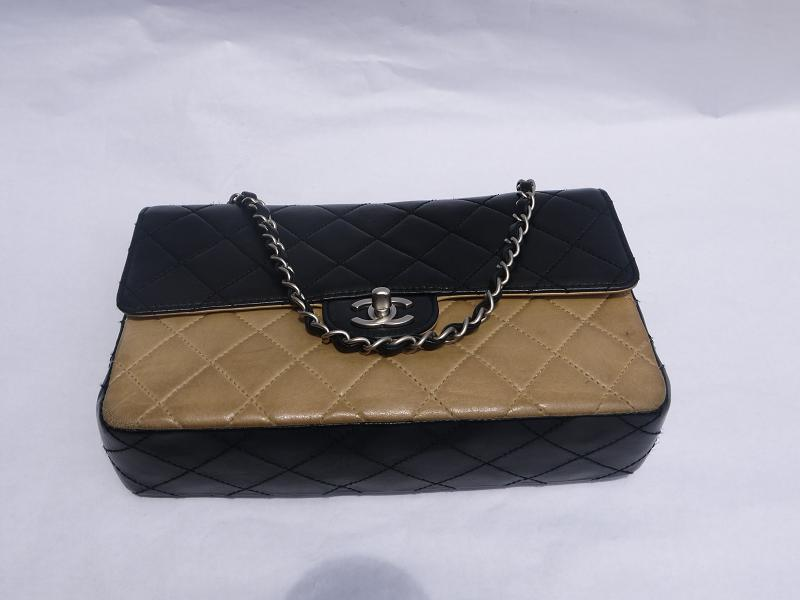 Truly Vintage Sold Chanel Two Tone Double Flap Bag