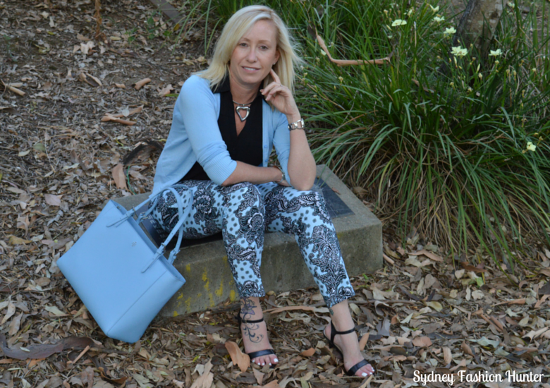 Blue Printed Pants, Black Sleeveess Shirt, Light Blue Cardigan, Light Blue Tote, Black Sandals