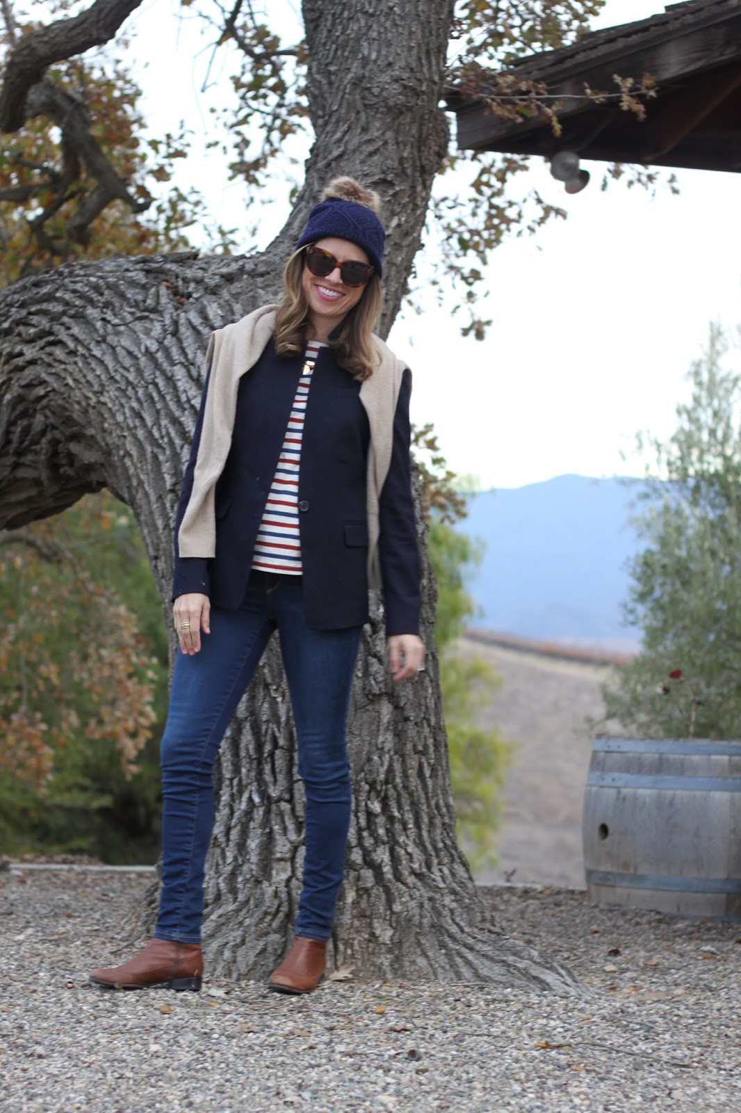 navy blazer and pom beanie