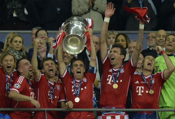 Bayern Munich captain Philipp Lahm lifts the trophy after winning the Champions League Final