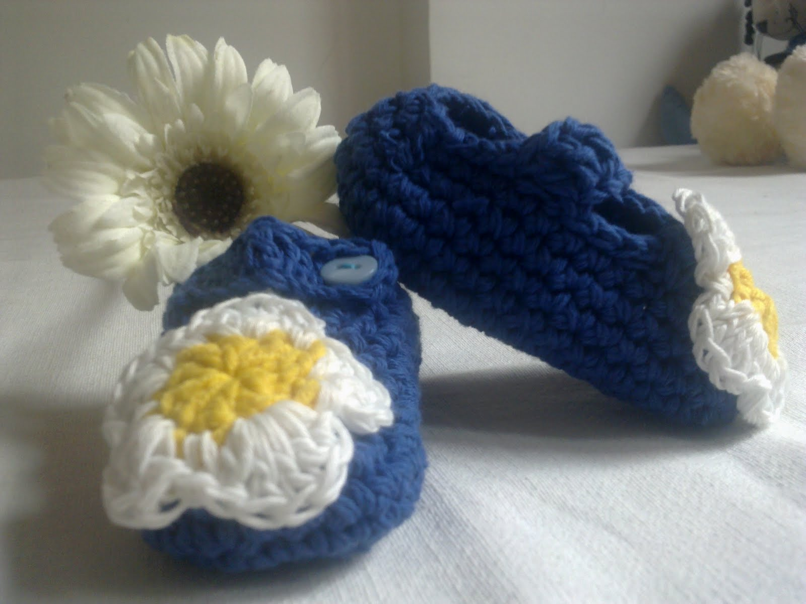 Hand-knitted booties for our little ones