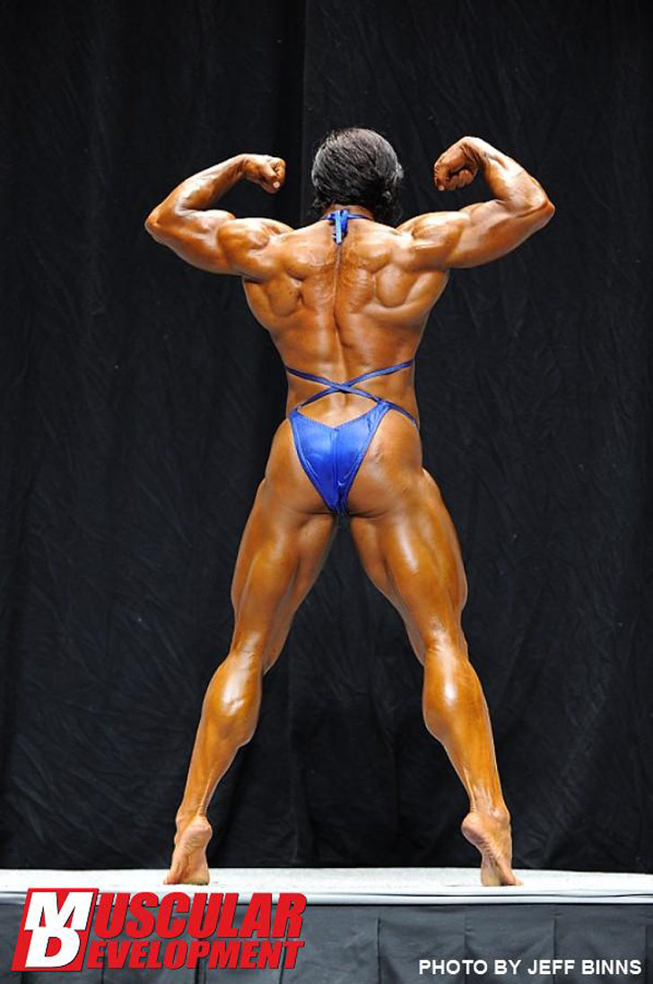 Karen Garrett In A Back Double Bicep Flex At The 2012 NPC USA Championships