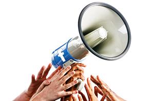 Hands grabbing a megaphone