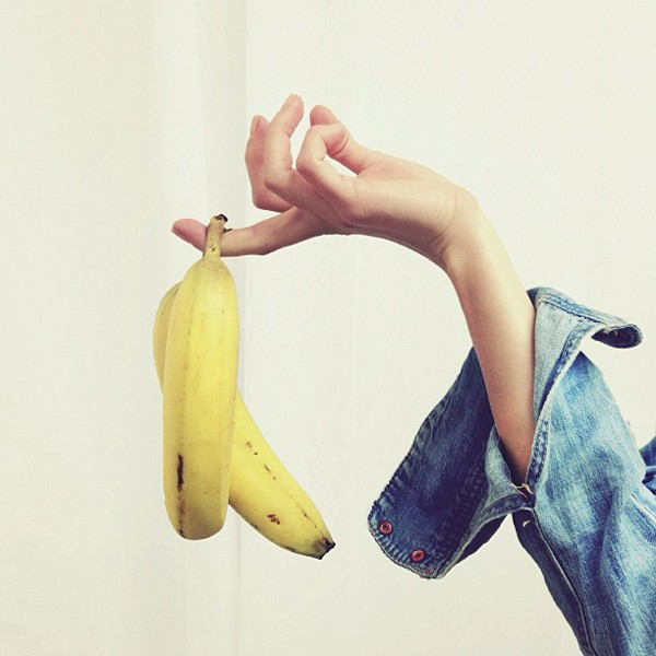 holding a banana, denim shirt