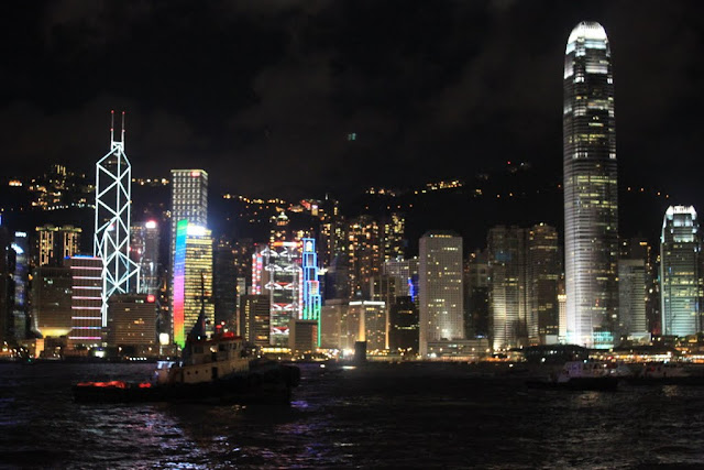 Twin buildings of International Finance Centre (IFC) and Bank of China Tower across Victoria Harbour from Tsim Sha Tsui Promenade in Hong Kong