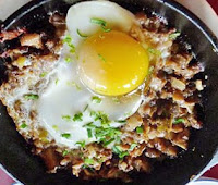 sizzling sisig is popular filipino recipes appetizer from pampanga, it is usually cook using pig with some spicy seasoning this filipino recipe is delicious but to fatty