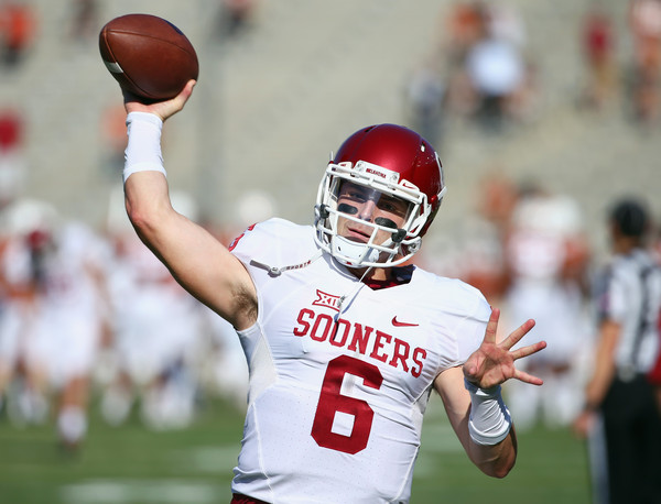 Baker Mayfield #6 of the Oklahoma Sooners works through pregame warmups before taking on the Texas Longhorns during the AT&T Red River Showdown at the Cotton Bowl on October 10, 2015 in Dallas, Texas.