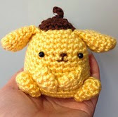 http://www.ravelry.com/patterns/library/crochet-purin-purin-artist-dog-doll-toy