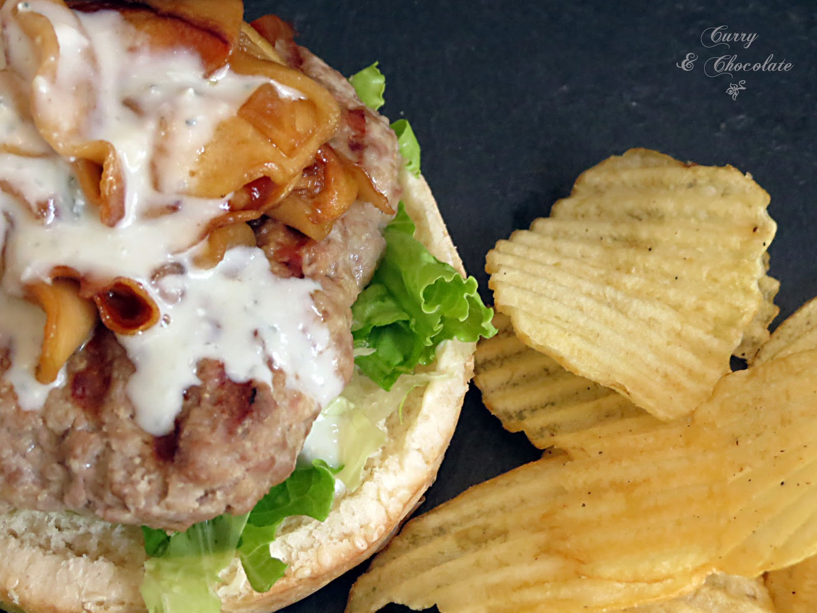 Beef burgers with caramelized apple slices and gorgonzola sauce