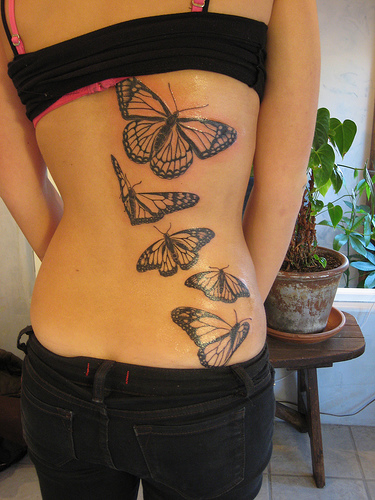 quote tattoo on rib cage. tattoo text rib sexy girls