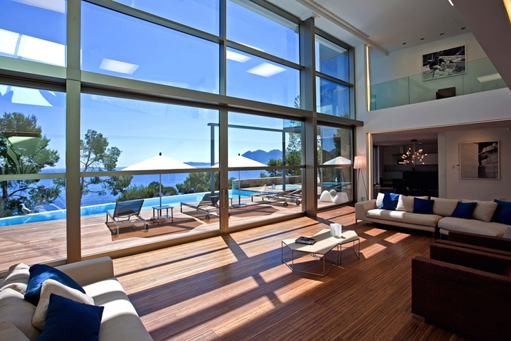 Glass wall in living room of Modern mansion on the cliffs of Mallorca