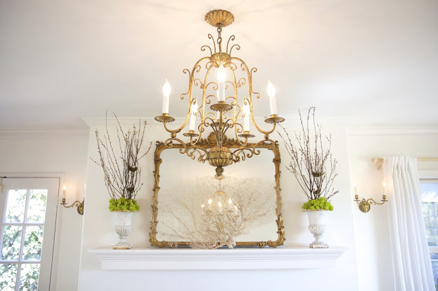 Living Room in the Nest; Cinderella gold-leaf chandelier, mantle, sconces; Nora's Nest
