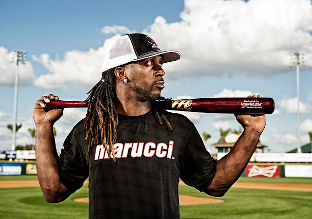 Portrait of Andrew McCutchen holding a Marucci Sports branded bat