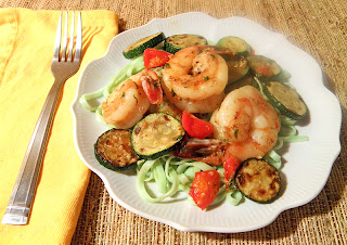 Plate of Shrimp, Zucchini, and Tomatoes with Pasta