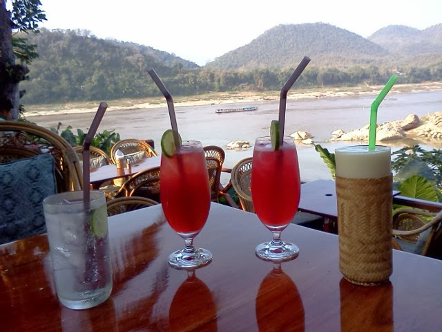 Singapore Slings, Gin & Tonic, and Mango Smoothie at the View POint Cafe of the Mekong River Hotel in Luang Prabang.