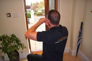 A Keytek local emergency locksmith working on a mortice lock on a wooden door