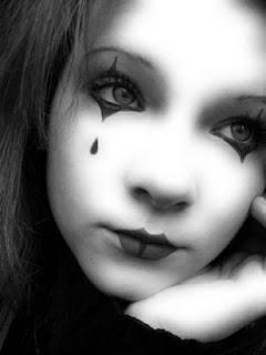un arlequin hermoso Fotografias tristes