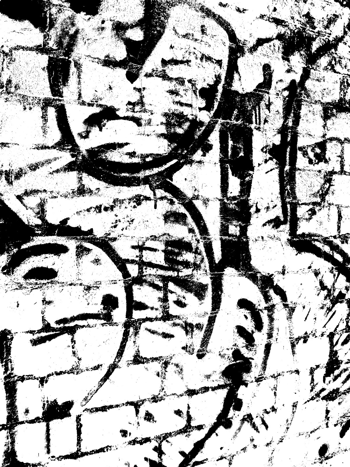 Graffiti under bridge with transposed colours in black and white