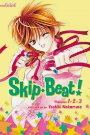 Cover of Skip Beat Volume One, featuring a red-haired Japanese girl dressed in a frilly pink sleeveless top. She winks at the viewer, her left hand hand extended in a mock punch and the other poised near her ear. Dark pink ribbons writhe around both her hands.
