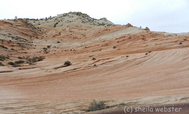 markings on the hillside look like lines drawn across the mountain