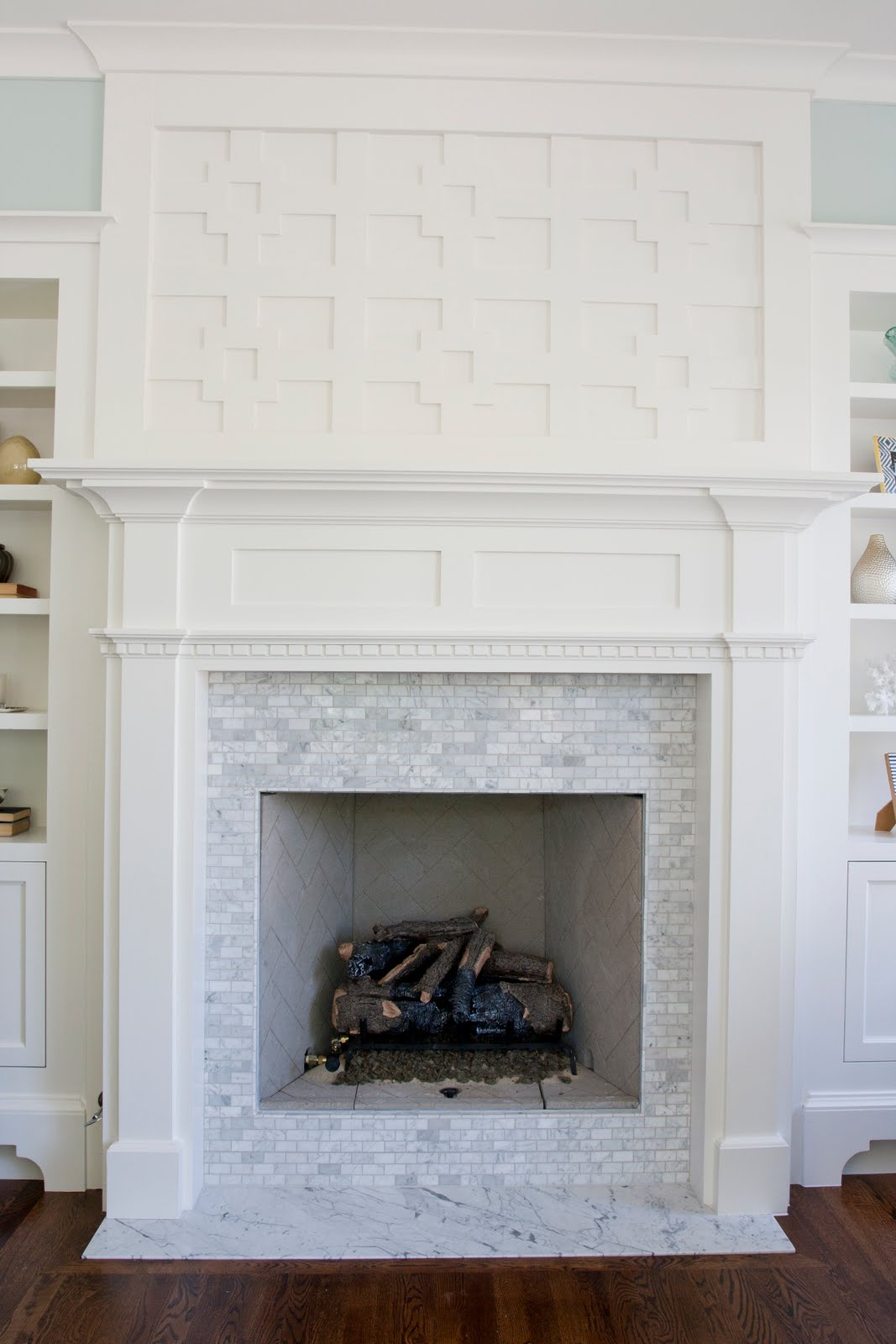 The granite gurus carrara marble fireplace hearths for Marble for fireplace surround