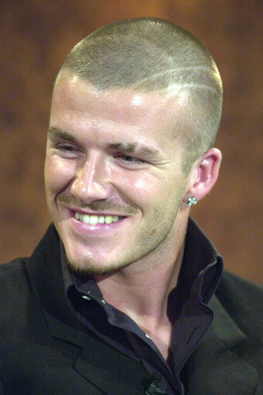 The long and short of celebrity hairstyles david beckham hairstyles 2002 at the 2002 world cup in south korea and japan beckham sported a fauxhawk or fake mohawk it was simple enough to do letting his hair grow a voltagebd Images