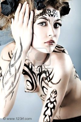 body paint gallery with lots of tattoos on body
