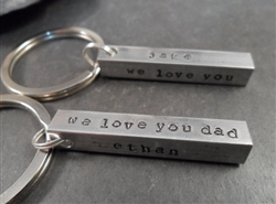 Personalized 4-sided solid metal bar keychain.