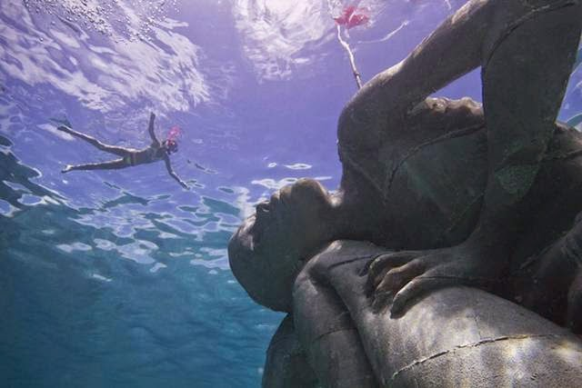 Ocean Atlas — Statue of a girl on the Ocean Floor