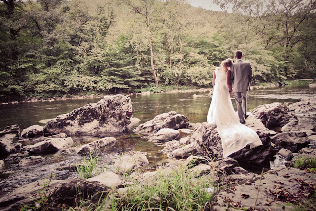 A bride and groom in front of a river in France