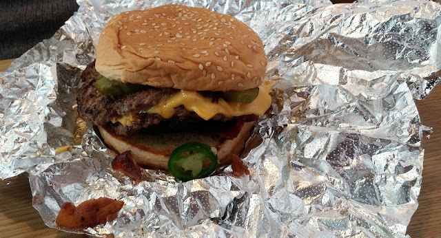 Five Guys bacon cheeseburger with jalapeno peppers