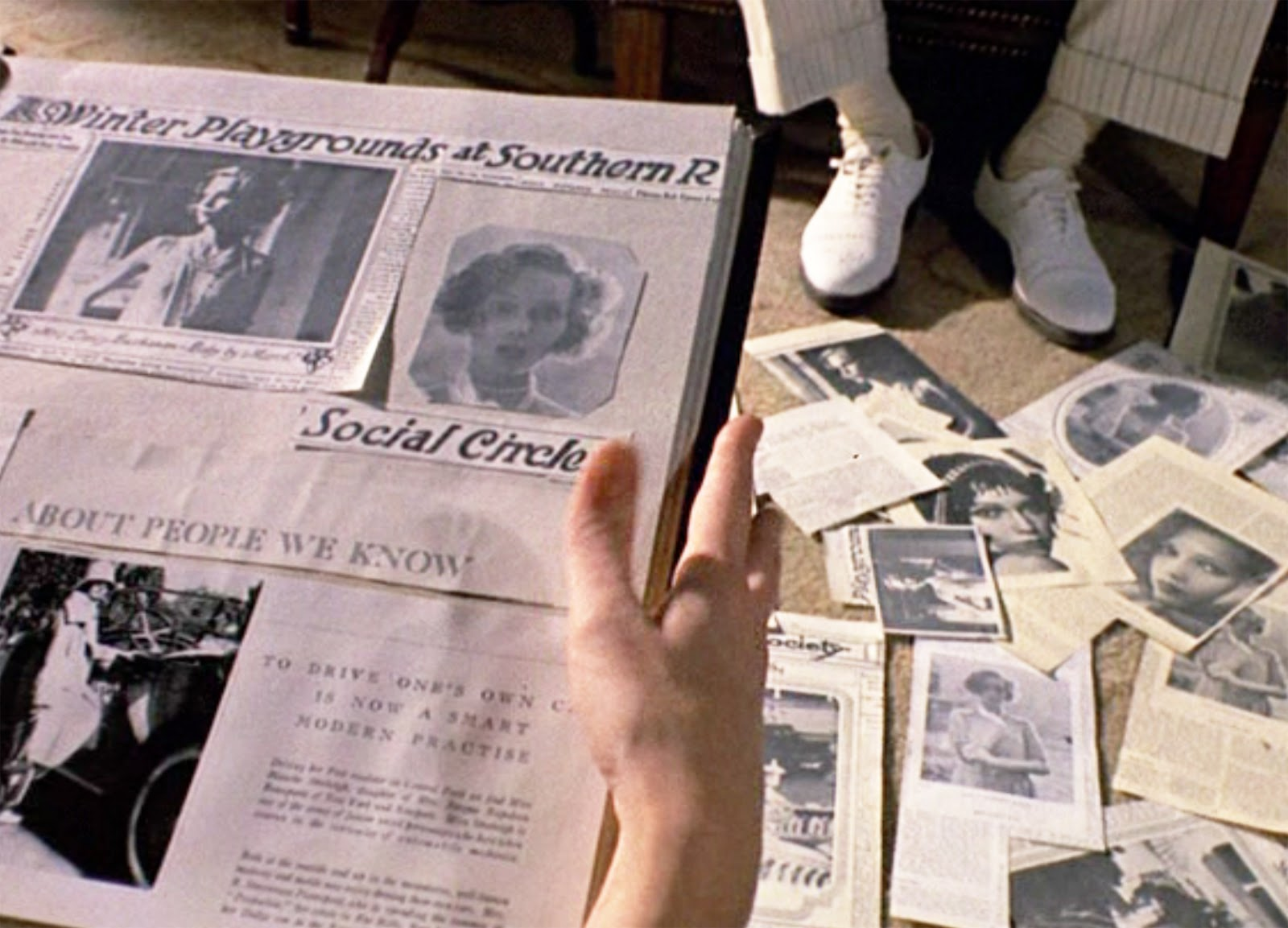 How to scrapbook newspaper clippings - Seen Here Daisy Buchanan Looking At A Scrapbook Of Newspaper Clippings Featuring Social Events