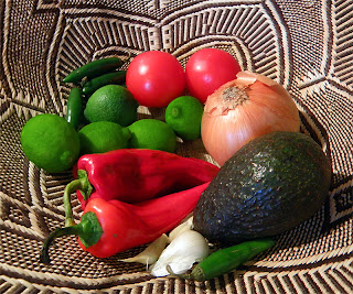 Basket of Limes, Jalapenos, Red Sweet Peppers, Avocado, onion, Tomatoes and Garlic
