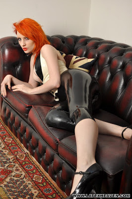 Sexy Redhead Ulorin Vex Relaxing in Tight Shiny Latex