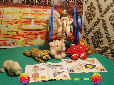 Bal Ganesh Reading Book Photos