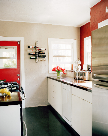 small kitchen white cabinets red door accent wall black floor counters interior design wall wine rack cococozy