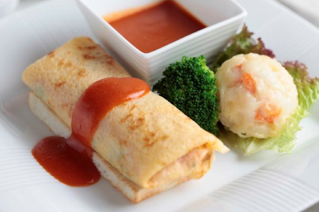 Early December special breakfast menu: traditional style chicken and spinach omelet wrapped with egg crepe