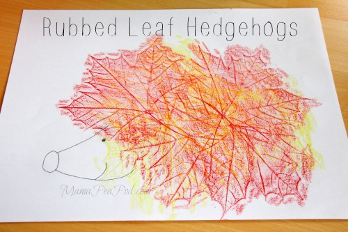 red and yellow hedgehog made from leaf rubbings